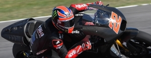 SAM LOWES ASTRIDE AN APRILIA RS-GP FOR THE FIRST TIME